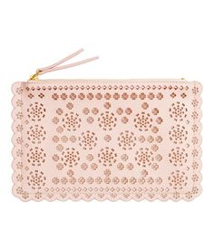 Small faux leather powder pink clutch bag with perforated patterns. | H&M Pastels