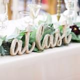 "This ""at last"" sign is a beautiful decoration for the tables of your wedding ceremony or reception. This wedding table sign is painted your choice color to match your wedding decor. This freestanding"