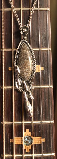Dinosaur bone set in .999 fine silver with a straw casting enhancement. First pendant of 2020 and new decade.