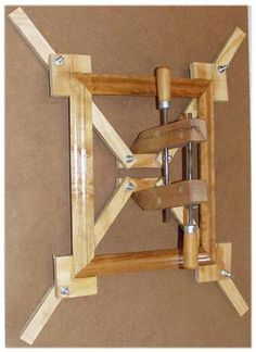 Self-Squaring Picture Frame Jig  Torture device?  Maybe. Amazing way to save myself waisted hours of my life, sweat and tears, and $ on trim and other supplies... definitely.