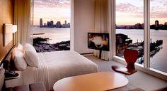 A Hudson Studio's floor-to-ceiling windows frame the Hudson River and Manhattan