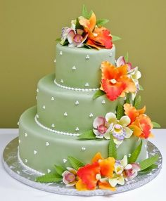 Beach Weddings - Tropical Cascade Cake by Jacques Fine European Pastries        either blue or pink?? match cupcake holders. use tropical flowers