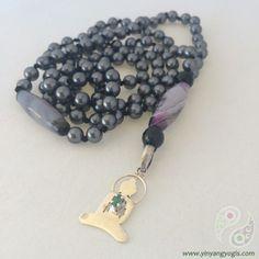 108 grey Swarovski Pearls enhanced by a sterling silver & emerald yogi