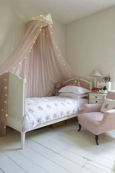 Cute and sophisticated girl's bedroom completed with lighted canopy and chair