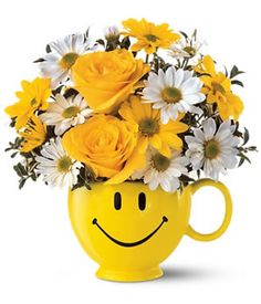 "Cheer someone up?or just share a happy thought with ""Always Smile"". Our joyful mug arrives brimming with yellow and white daisies and roses. It's just like delivering smile to loved ones doorstep. Send it now to anywhere is USA only $60 (Standard)."