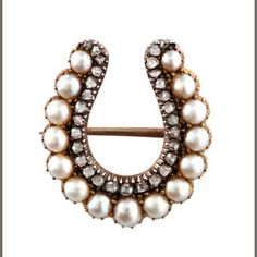 A Victorian diamond and half-pearl horseshoe brooch in the form of a lucky horseshoe. (Bonhams)