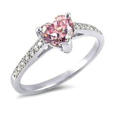 #pinkdiamond To Your most different girl, probably the most rare of precious stones, the Purple Diamond! This gorgeous ring is about with a Coronary Heart formed heart stone and incorporates 14 more lovely stones set into the shank. - See more at: http://blackdiamondgemstone.com/jewelry/wedding-anniversary/promise-rings/184ct-pink-diamond-heart-ring-14k-gold-com/