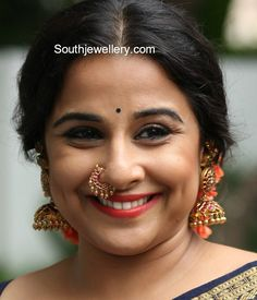 Vidya Balan in antique gold long jhumkas studded with kundans paired with kundan nose ring and kundan kada. Vidya Balan in antique gold long jhumkas studded with kundans paired with kundan nose ring and kundan kada. Nath Nose Ring, Nose Ring Jewelry, Bridal Nose Ring, Gold Nose Rings, Nose Ring Stud, Diamond Nose Ring, Gold Nose Stud, Nose Pin Indian, Indian Nose Ring