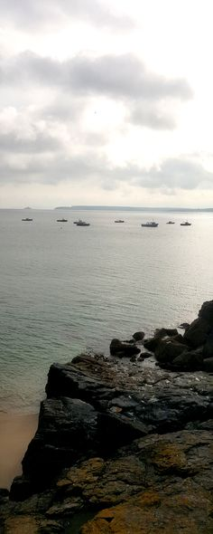 grey sea and ochre lichen rocks - St. Ives bay to Godrevy in Cornwall