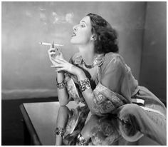 Shelly Napier 1938  wearing mist-blue tea gown under cafè-au-lait chiffon coat by Jessie Franklin Turner, necklace and bracelets by Tiffany.  Photo Louise Dhal-Wolfe.