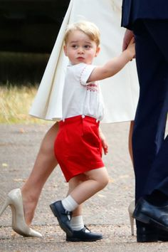 Prince George holds hands with Prince William on his way to Princess Charlotte's christening in July 2015.