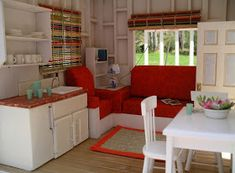 Here's a little one room beach house, inspired by a colorful reed placemat.  The house is up on stilts, like a proper beach house. Here's a...