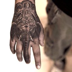 Niki Norberg is the artist who inked this spiritual tattoo of Ganesha on the back of a hand. Visit Niki's Facebook page at https://www.facebook.com/niki23gtr