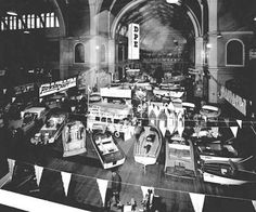 1960s Melbourne A display of recreational and motor boats under the dome of the Exhibition Building, with bunting in the foreground.