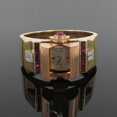 1950-s-Retro-THM-4-5ct-Ruby-0-30ct-Dia-14K-Y-Rose-Gold-Glycine-Bangle-Watch