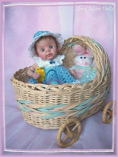 http://www.ebay.com/itm/OOAK-HAND-SCULPTED-BABY-GIRL-COLLECTOR-TASHA-JONI-INLOW-DOLLY-STREET-/160736415022?pt=LH_DefaultDomain_0&hash=item256ca30d2e