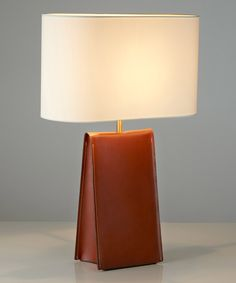 A leather table lamp ideal for hotel, yachts, hospitality and residential lighting. Modern Lighting Design, Interior Lighting, Retro Interior Design, Led Shop Lights, Deco Originale, Residential Lighting, Fabric Shades, Light Table, Desk Lamp