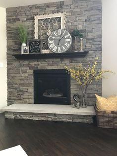 My fireplace..Metal Frame, Home sign, & clock (Hobby Lobby). Candle sticks at TJ Maxx (modern farmhouse decor hobby lobby)
