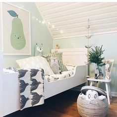 Happy kid room in mellow colors, great for night nights.