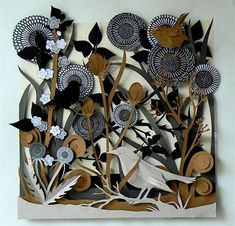 Helen Musselwhite 's beautiful paper cut tableau. Collage and laser cutting to create texture.