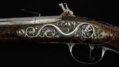 EXTREMELY RARE AND DESIRABLE STEEL MOUNTED LONG ENGLISH FLINTLOCK HOLSTER PISTOL BY THE RENOWNED HUGUENOT GUNMAKER JOHN DAFTE CIRCA 1690. During the last quarter of the 17th century English gunmaking was enriched by the immigration of Huguenots fleeing Catholic persecution on the Continent. Among the finest were Monlong, Dafte, Barne, Gandon, Paris, Barbar, Gorgo, Trulocke, Turvey, Wynn, and Delaney. This pistol by Dafte is a surperb example of late 17th century English gunmaking at its…