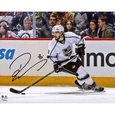 "Drew Doughty Los Angeles Kings Fanatics Authentic Autographed 8"" x 10"" White Jersey Skating With Puck Photograph - $99.99"