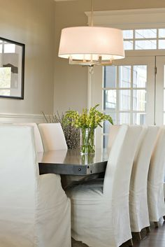 Pretty slip covered chairs, light and hammered nail detail on edge of table