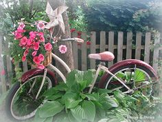 I have an old bike leaning against a tree in my backyard that I plan to build a garden around...I plan to put flowers in the basket like this one but I never thought about the pinwheel....I love this whimsical idea....dollar store here I come!!!