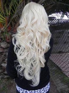 long, white blonde curly hair