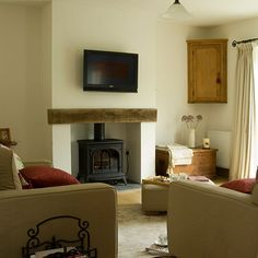 Living room with woodburning stove | Living room decorating