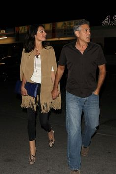 Amal Clooney wore a Yves Saint Laurent fringed cape with black skinnies, blue python clutch and Gucci python horsebit ankle boots. Valentine's Day 2015 - Studio City, CA.