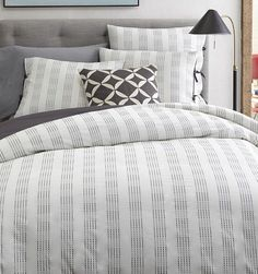 light #grey striped bedding http://rstyle.me/n/intyzr9te