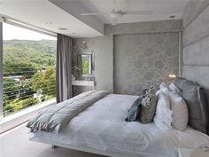 Grey bedroom with upholstered headboard wall