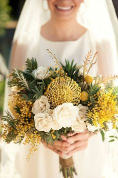 """Australia Natives"" Wedding Bouquet Featuring: Yellow Pin Cushion Protea, Yellow Mimosa Flower, Yellow Craspedia, White Tea Roses + Various Greenery & Foliage"