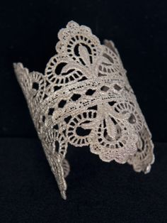 This cast bronze cuff is intricate yet durable. It sits very nicely right past the wrist.