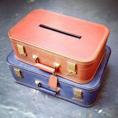 Vintage suitcases used as card box for a wedding reception.  Simply cut a slot in the top case, stack on top of a larger case and you have a unique card holder to fit in with a vintage theme!