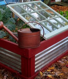 Old Window Lean-To Cold Frame! Prop an old window up over greens in your raised bed to extend the season! DIY ~ Tucking the garden in for the winter at Our Fairfield Home and Garden http://ourfairfieldhomeandgarden.com/diy-tucking-the-garden-in-for-the-winter-at-our-fairfield-home-garden/