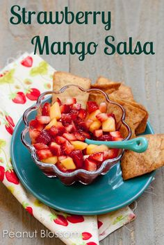 Strawberry Mango Salsa with cinnamon pita chips: fresh and healthy appetizer or treat. Love bringing this to a potluck party or for serving at spring or summer gatherings.