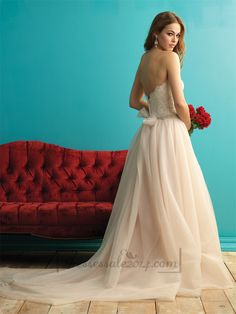 This sweet strapless gown is every bit an ethereal, delicate dream.