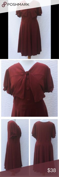"""New Eshakti Red Retro Fit & Flare Dress 32W New Eshakti lakehouse red knit retro style fit & flare dress. 32W Measured flat: underarm to underarm: 55 1/2""""  Waist: 53"""" Length: 45"""" Eshakti size guide for 32W bust: 60"""" Short fabric covered button front closure. Princess seamed bodice, banded waist, side hidden zipper, side seam pockets, flared skirt, below knee length. Short sleeves w/ partial elastic at cuff. Cotton/spandex, woven jersey knit, light stretch. Machine wash. New w/ cut out…"""