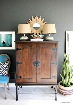 Hi Sugarplum | Tuck your TV away in a stylish cabinet & decorate with HomeGoods lamps & accessories. (sponsored pin)