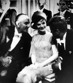 Vice-President Lyndon Johnson,  the First Lady, and President Kennedy attending after-dinner entertainment in the White House following one of many formal State  Dinners........