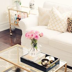 White and gold interior decor. Pop of pink flowers