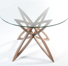 Star Table: Glass top, beautiful legs that can be seen from all angles because of glass top. Star base American Walnut
