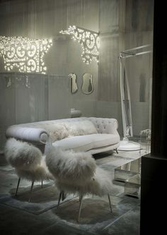 White fairy-tale inspired living room with white leather and Mongolian lamb cushions - dreamy!