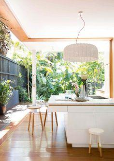 White, light wood and greenery