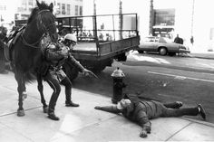 A mounted NYPD officer arrests a robber in 1988