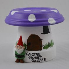 Gnome Home Hand-Painted Flower Pots by Treasure Coast Creations & Designs Choose your topper under the color variation option! Choose from: Red Blue Yellow Green Purple *Please note: each gnome will vary! Photos used to show sample products.* Each pot measures approx. 2.5 Tall