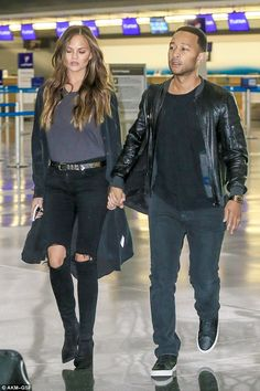 Touchdown: Chrissy Teigen and John Legend jetted into New York late on Tuesday without baby Luna