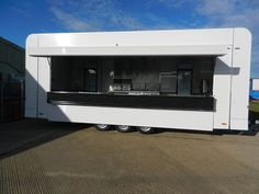 Fish and Chip mobile catering trailer with roll  out serving front for extended extra space